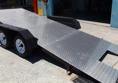 Newly manufactured tilt car trailer